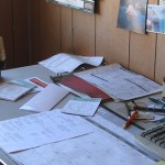 Picture of desk with various clutter